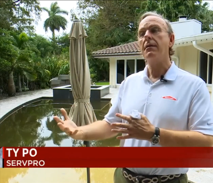 Image of Ty Po SERVPRO being interviewed by Local 10 News
